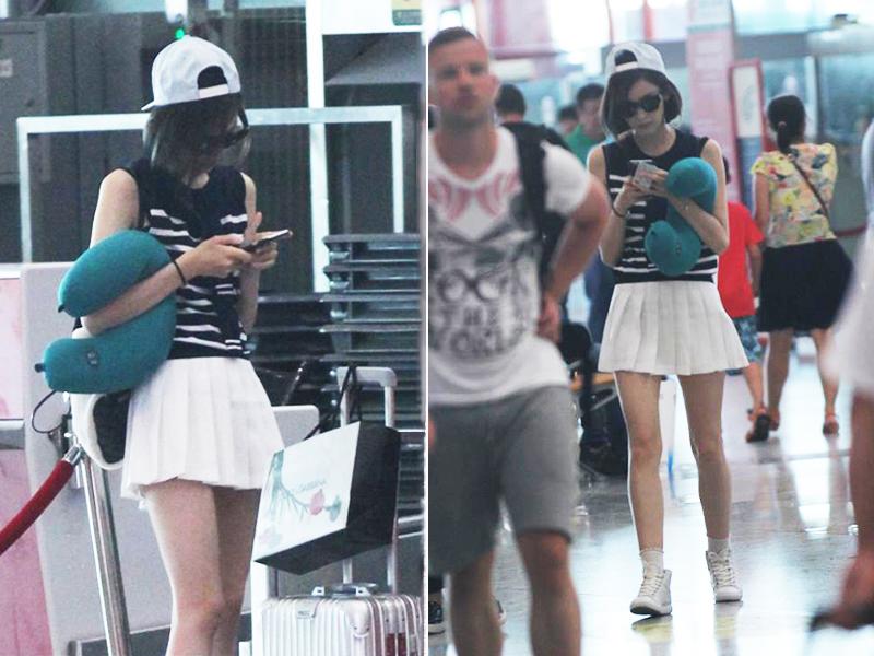 古力娜扎机场露美腿,条纹衫配短裙俏皮活泼