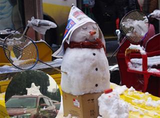 苦等20年终于下了场雪,为庆祝重庆人民把雪人请上车顶!