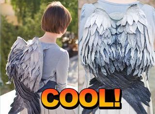 她亲手制作了天使翅膀背包  一背上就成为焦点