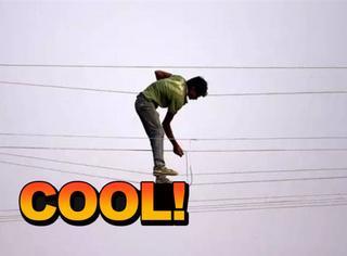 这不是杂技演员,而是印度的电工