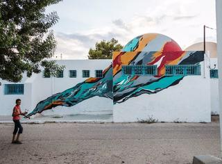 150位艺术家占领了村庄之后,墙壁就被画成这样了...